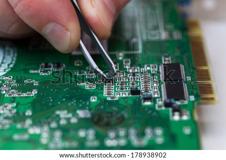 close up of repairing circuit printed board - stock photo