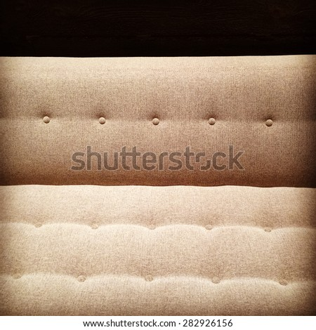 Close-up of retro-styled sofa in warm light. - stock photo