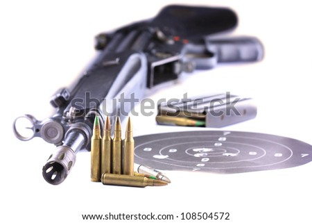 Close up of rifle and bullets on white background - stock photo