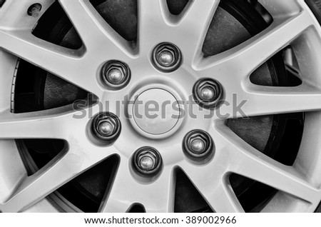 Close up of rims from a sport car in black and white - stock photo