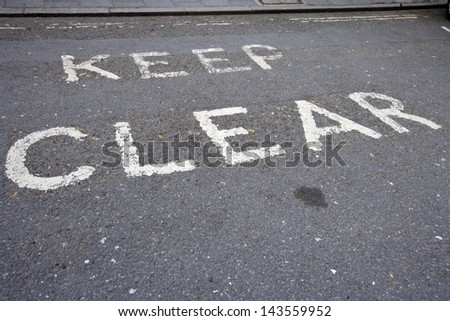 Close-Up of road marking saying Keep Clear in London, UK - stock photo