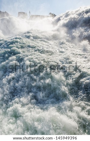 Close up of roaring Rhine Falls in Switzerland - stock photo