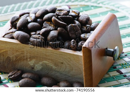 Close-up of roasted coffee beans. Full box. - stock photo