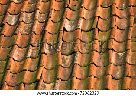 Close up of roof tiled with old pantiles - stock photo