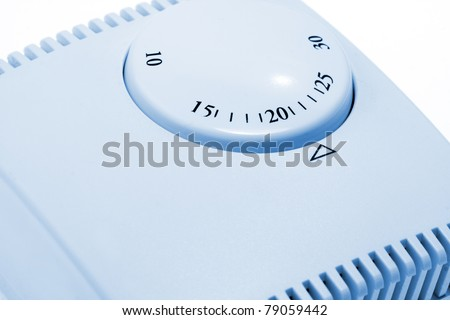 Close-up of room thermostat. Toned in blue - stock photo