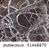 Close up of rose colored marble with white veins fills frame - stock photo