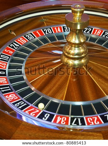 Close up of roulette wheel with ball on 27
