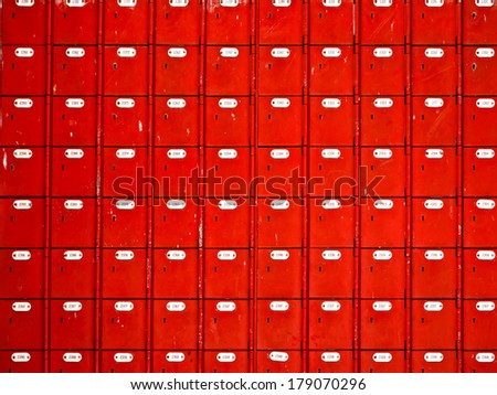 close up of rows of red mailboxes - stock photo