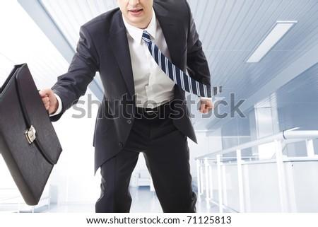 Close-up of running businessman - stock photo