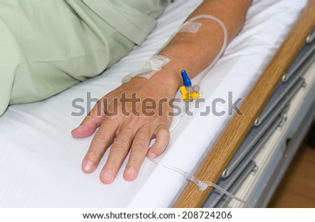 close up of saline solution with patient - stock photo
