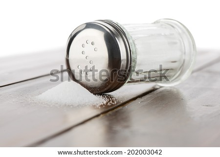 Close-up of salt shaker on table    - stock photo