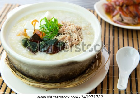 Close up of salted and preserved egg chicken floss congee - stock photo