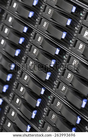 Close up of SAN storage hard drives in datacenter - stock photo