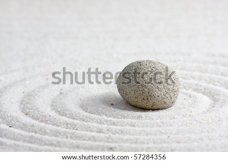 Close up of sand zen garden with stone - stock photo