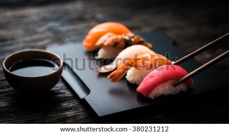close up of sashimi sushi set with chopsticks and soy - stock photo