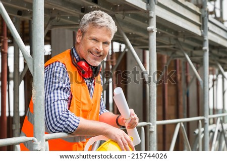 Close up Of Satisfied Mature Architect looking at camera - stock photo
