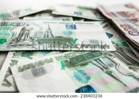 Close-up of scattered russian banknotes - stock photo