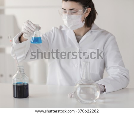 close up of scientist making test in lab - stock photo