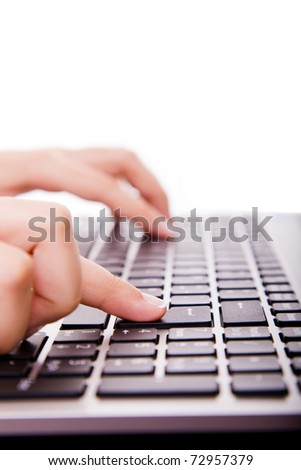 Close-up of secretary hand touching computer ENTER key during work
