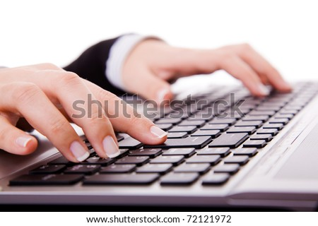 Close-up of secretarys hand touching computer keys during work