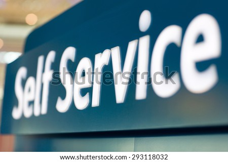 close up of self service sign at airport - stock photo