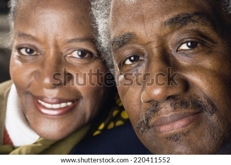 Close up of senior African couple smiling - stock photo