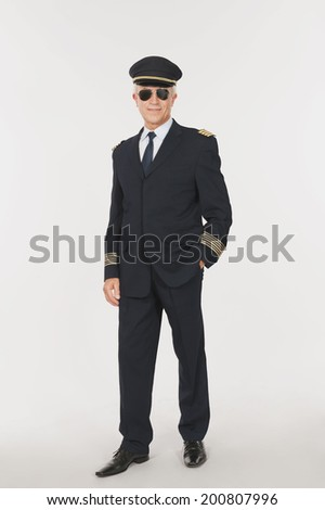 Close up of senior flight captain standing on white background