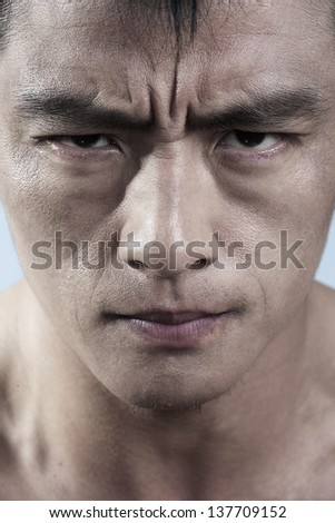 Close up of serious young mans face