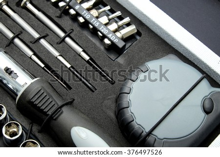 Close up of set of tools in box. Focus on center. - stock photo