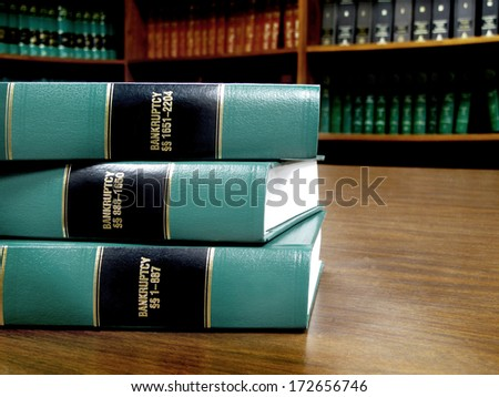 Close up of several volumes of law books of codes and statutes on bankruptcy - stock photo