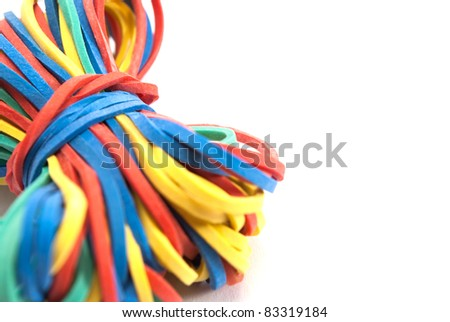 Close up of sheaf rubber bands stationery, isolated on white. - stock photo