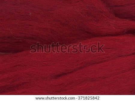Close up of sheep wool texture. Red wool background - stock photo