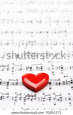 close up of sheet music with heart - stock photo