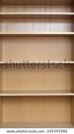 Close-up of shelves of a new empty book-case
