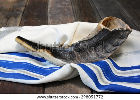 close up of shofar (horn) on white prayer talit. room for text. rosh hashanah (jewish holiday) concept . traditional holiday symbol.  - stock photo