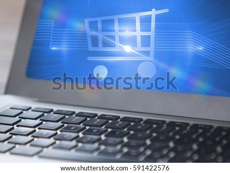 Close-up of shopping cart symbol on laptop