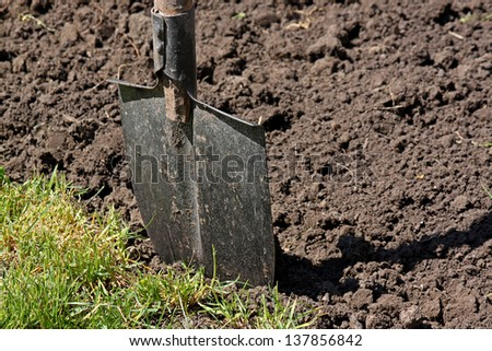 close up of shovel in a ground