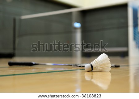 Close up of shuttlecock and racket in badminton game - stock photo