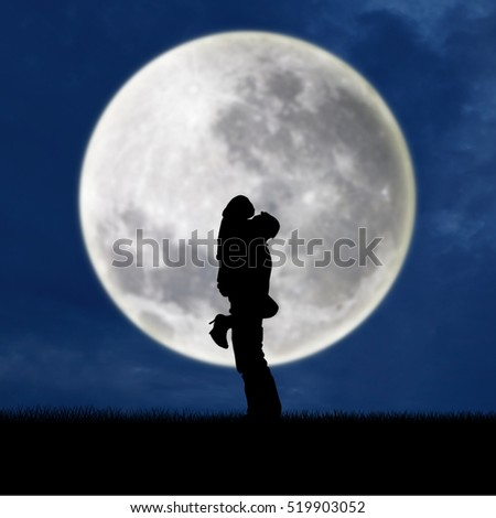 Close-up of silhouette couple hugging on full moon