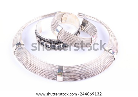Close up of silver gold jewelery / bracelet in round shape for fashion and beauty background - stock photo