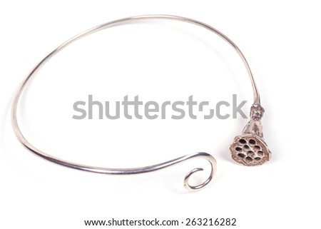 Close up of silver necklace isolated on white background, manufactured by Ornella Salamone - stock photo