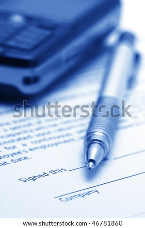 Close-up of silver pen and mobile phone on employment agreement. Selective focus on top of pen. Toned monochrome image. - stock photo