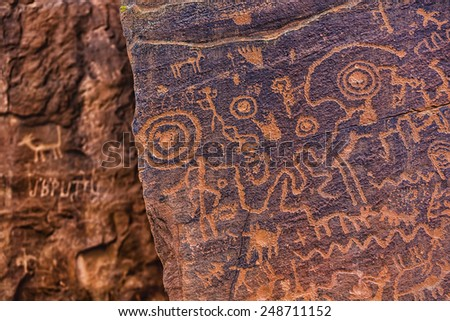 Close up of Sinaguan petroglyphs with modern graffiti in background - stock photo