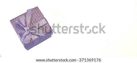 Close Up Of Single Violet Or  Lilac Gift Box With Dotted Pattern, Ribbon And Bow, Isolated On White Background,  Horizontal Image With Copy Space, Top View - stock photo