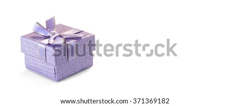Close Up Of Single Violet Or  Lilac Gift Box With Dotted Pattern, Ribbon And Bow, Isolated On White Background,  Horizontal Image With Copy Space, Front View - stock photo