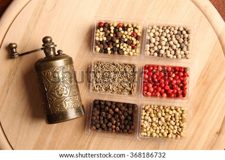 Close-up of six species of spices and Mill - stock photo