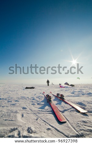 Close up of skis and the person in a distance - stock photo