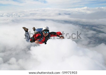 Close up of skydiver in freefall - stock photo