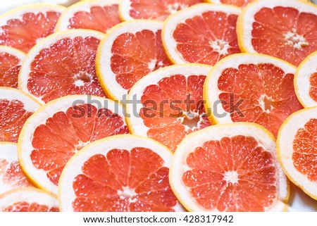 Close up of sliced grapefruit as a background. - stock photo