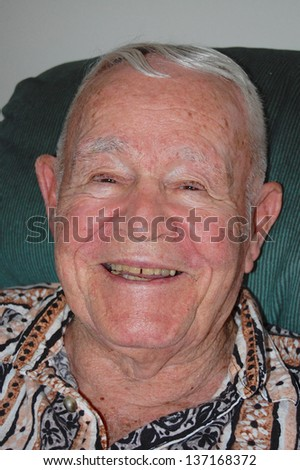 Close-up of smiling elderly man. - stock photo